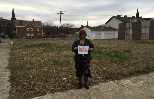 Rhonda Moorer stands on a vacant lot in McKeesport