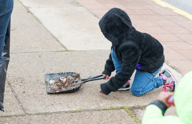 Youth sweeps stree